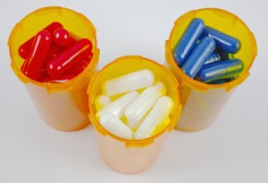 red, white, and blue capsules in pill bottles