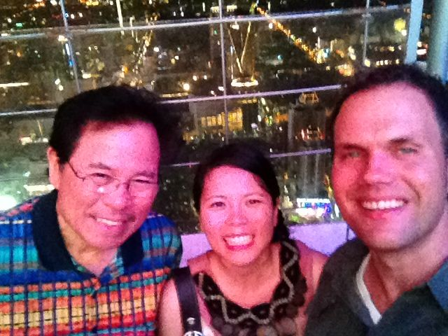 "The happy ""after"" pic. With Jammie's dad atop Baiyoke Tower II - the tallest building in Bangkok.... if only we could have skipped the ""we're leaving"" conversation..."